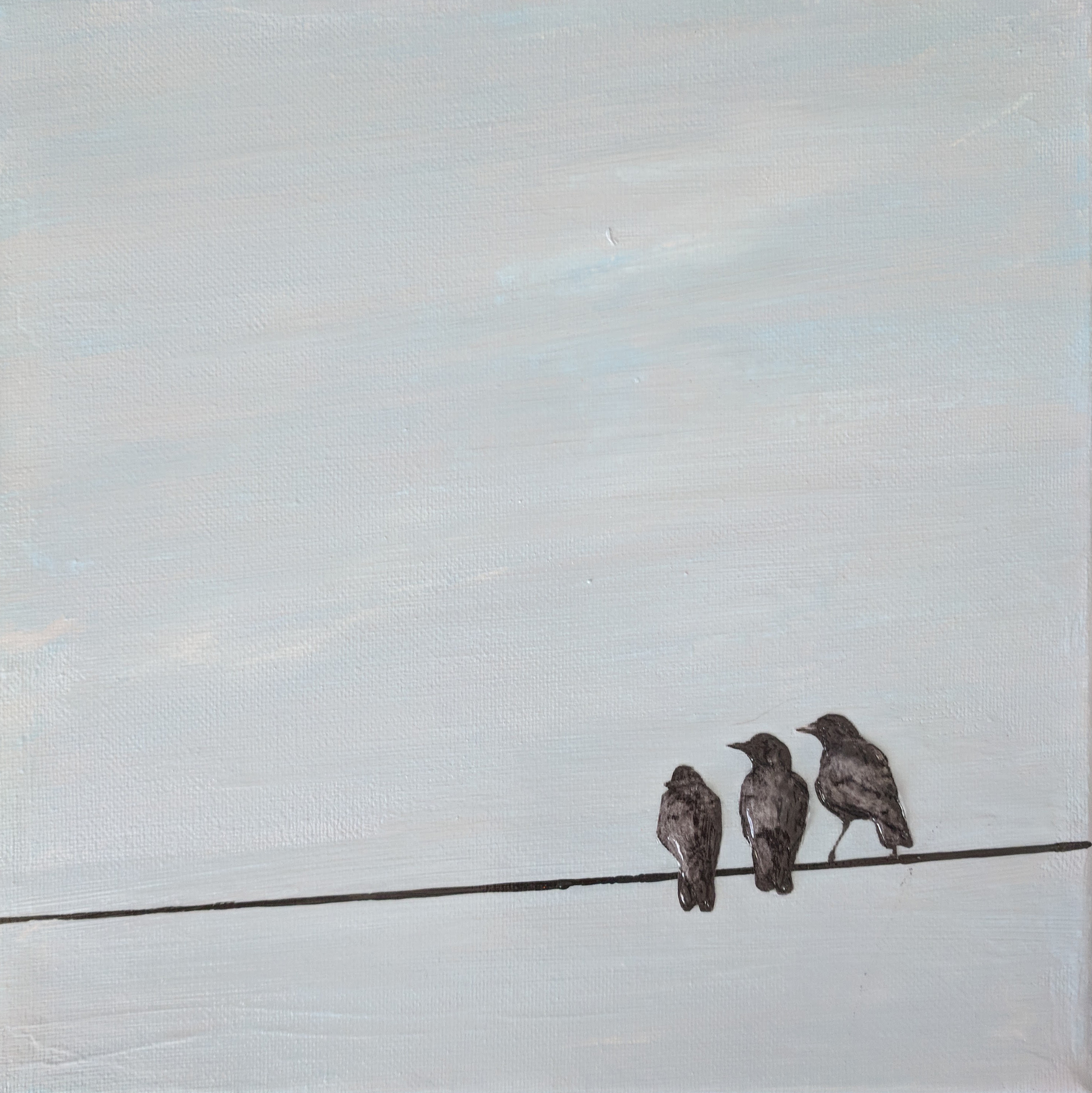 3 crows on a wire